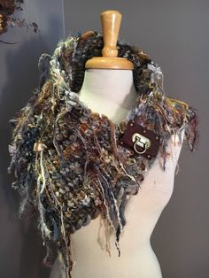 A personal favorite from my Etsy shop https://www.etsy.com/listing/572867330/reserved-handknit-boho-cowl-with-leather