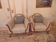 Lot 266 - A pair of Italian mahogany and parcel-gilt bergeres, an interesting reinterpretation of late 18th