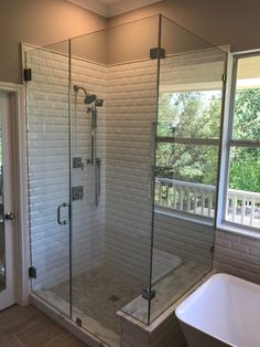 Custom Glass Shower Enclosure - Frameless 90 Degree Glass Shower Enclosure with Notched Inline Panel. Contact Arrow Glass and Mirror, located in Austin, TX today to learn more 512-339-4888 or email sales@glassgang.com.