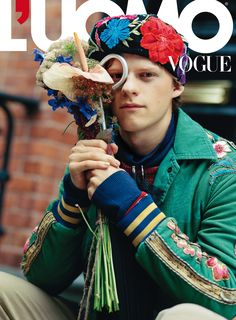 Gucci Editorials American actor Lucas Hedges, shot by Bruce Weber, in wool pants, a hooded sweatshirt and jacket with patch details from Gucci Spring Summer 2017 by Alessandro Michele for the January cover story of L'Uomo Vogue. Fashion editor: Paul Cavaco