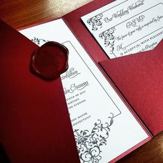 Red custom wax seal paired with a red pocket folder and letterpressed wedding invitation.  | Invitations by Ajalon | invitationsbyajalon.com