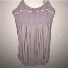 LuLu flowy tank! Lilac size 8/10, soo comfortable Amazing workout out tank, many compliments! Just looking to change up my wardrobe a little! Exc condition and has a built in bra! Please, no lowball offers  lululemon athletica Tops Tank Tops