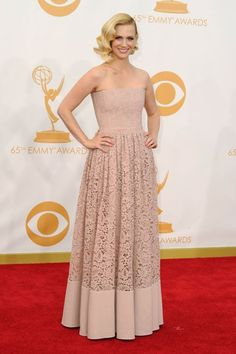January Jones arrives at the 65th Primetime Emmy Awards at the Nokia Theatre in Los Angeles on September 22, 2013.  I'm disappointed in her choice... a blah color for her, the corset could be more flattering, and the skirt reminds me of a bedspread my great aunt had...