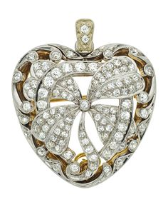 Diamond, Platinum-Topped Gold Pendant-Brooch, early 20th century The pendant-brooch features European and Swiss-cut diamonds weighing a total of approximately 3.50 carats, set in platinum-topped 14k gold