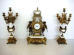 Antique gilt clock and candelabra set