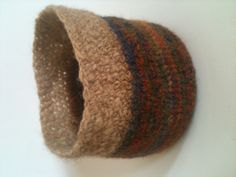 Hand knit pure wool vessel with crochet top of hand spun tops. Now sold.