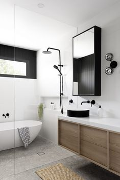 Home Remodel Diy Dark joinery and pops of terrazzo steal the show in this modern home makeover. Black and white bathroom with VJ wall panels and terrazzo tile floor. Timber vanity and mirrored cabinet, black sink in bathroom, black tapware Laundry In Bathroom, Bathroom Storage, Small Bathroom, Master Bathroom, Bathroom Black, White Bathroom Wall Tiles, Modern Bathroom Cabinets, Modern White Bathroom, Master Master