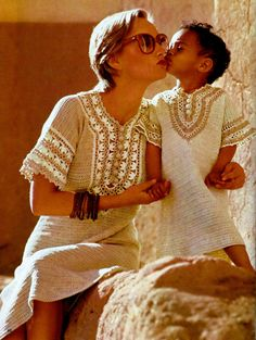 Breezy matching caftans, cover-ups or summer dresses for Misses and Girls sizes have lace trim around sleeves and front neck openings. Caftans are A-line and include button closures at neck.  MOM'S CAFTAN SIZES: Misses' 10-12-14. Directions for sizes 12 and 14 are given in parentheses. Measurements for first size are given on chart.  MATERIALS: Cotton crochet thread No. 5; fourteen (fourteen-fifteen) 50-gr balls (175 yds per ball) distributed as follows: Twelve (Twelve-Thirteen) balls in…