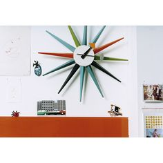 MLF George Nelson Sunburst Clock (145,755 INR) ❤ liked on Polyvore featuring home, home decor, clocks, sunburst clock, sunburst wall clock and sun burst clock