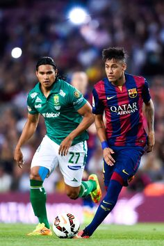 Neymar of FC Barcelona competes for the ball with Carlos Pena of Club Leon during the Joan Gamper Trophy match between FC Barcelona and Club Leon at Camp Nou on August 18, 2014 in Barcelona, Catalonia.