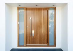 PP107 A curved and straight drop solid stainless steel pull handle.  Available at 950mm in length.  Suitable for doors up to 90mm in thickness. Front Door Images, Modern Front Door, Front Door Design, Stainless Steel Door Handles, Black Door Handles, Luz Natural, Hardwood Front Doors, Door Picture, House Cladding