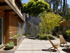 Mid-century modern home renovation in Berkeley Hills, lovely staircase to patio