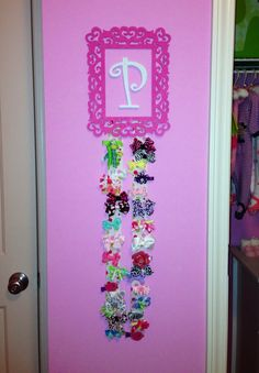 """DIY bow holder! Would totally spell out """"BOWS"""" in the middle of the frame"""