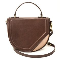 NERINA It is destined to be talked about,   due to its harkening back to the  haversacks of the truffle hunters  and their typical settings in the  villages of Valnerina. Woman's bag in rigid, smooth, hand-colored, vegetable-tanned Tuscan leather.  http://www.vodivi.com/shop/en/home/11-nerina.html