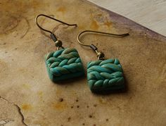 Hand made clay knit jade earrings.