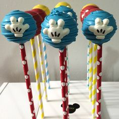 Love these adorable Mickey Mouse inspired cake pops displayed on colorful paper straws!