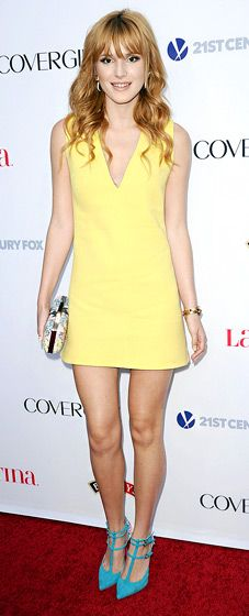 Bella Thorne in a lemon-yellow v-neck mini-dress by Fausto Puglisi and blue Sophia Webster ankle-strap pumps.