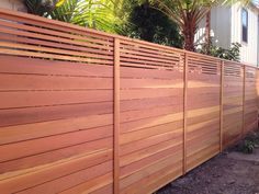 Photo of Aanco Fence - Spring Valley, CA, United States. Custom horizontal fence with picket accent top.. Stained natural..