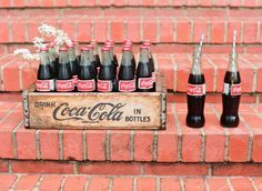 Drinking a little coca cola on a sunday never went amiss. Especially out of wee glass bottles. On some brick steps.