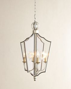 """Nolan Lantern by Visual Comfort at Horchow. $750 Designed by John Rosselli Burnished silver-leaf finish; finish may patina over time. Uses four 60-watt bulbs. 5""""Dia. ceiling canopy included. 14.25""""W x 14.25""""D x 24.75""""T with 6'L chain. Imported. Weight, 11 lbs. Boxed weight, approximately 14 lbs."""