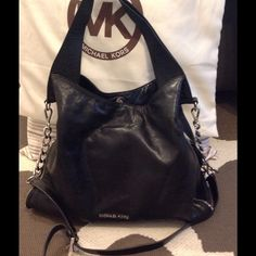 Authentic MK Devon handbag! large shoulder bag One of my fav bags!! Black supple leather, pre-loved condition. Silver hardware. Comes with dust bag and tags. W 14, D4 1/2, H 11 1/2 strap drop 13, handle drop this has handles and an accessory chain strap, removable and adjustable. Side zipper detail. Marks on liner. Must pull liner out to actually see, makeup stains, last picture. Not noticeable unless you pull out lining. Some light distressing from wear MICHAEL Michael Kors Bags Shoulder…