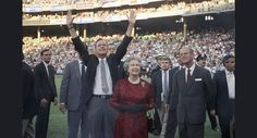 President George H. Bush escorts Queen Elizabeth II and Prince Philip on the field at Memorial Stadium on Wednesday, May 15, 1991 in Baltimore, before the Orioles played the Oakland A's. The Queen watched her first baseball game. (AP Photo/Greg Gibson)