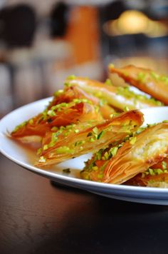 Shaabiyat Kacha | Lebanese cream filled pastry puffs with pistachios, rosewater and sugar syrup.