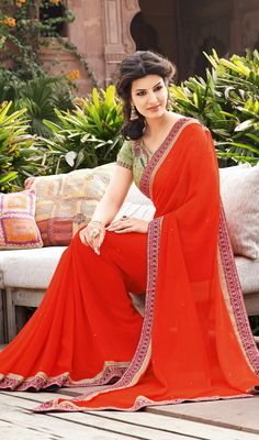 Appear Stunningly Gorgeous In This Coral Chiffon Saree. The Charming Lace Patch Work Resham Stones Work A Considerable Element Of This Attire Indian Dresses, Indian Outfits, Indian Clothes, Orange Saree, Chiffon Saree, Satin Saree, Indian Sarees Online, Looks Chic, Indian Attire