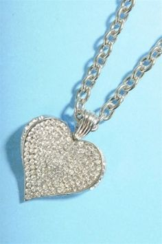 Believe bling heart. This heart is slightly curved and includes a beautiful chain.