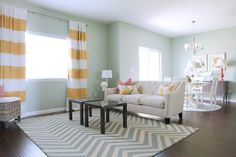 Love the pop of color in the window treatments
