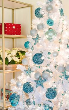 Sharing our budget friendly blue + white Christmas tree full of glittered ornaments and blue beaded garland.