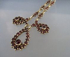 Beautiful Vintage Bohemian Garnet Necklace circa 1950s. This is designed in an Edwardian lariat design with deep red Bohemian garnet gemstones.  The necklace is made of 900 silver with a gold wash. The piece is marked G2 with other faint markings which have been rubbed with age. This is in good vintage condition, there is a little light wear to the silver gilt and the garnet gemstones are in very good condition no cracks or nibbles. A lovely piece style which would be perfect for evening…