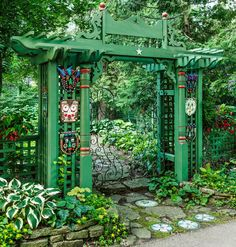 Garden Designs Ideas 2018 : An entry arch puts Doug and Barbara Henderson's love of art, salvaged materials, and shade plants on display, combining vintage corbels and pilasters with some of Barbara's fused-glass masks. Love Garden, Glass Garden, Garden Art, Garden Ideas, Front Porch Plants, Salvaged Decor, Mosaic Stepping Stones, Garden Landscape Design, Landscape Designs