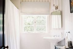 I don't know why cute bathrooms are so appealing to me. And I love the wallpaper!! And the black on white.