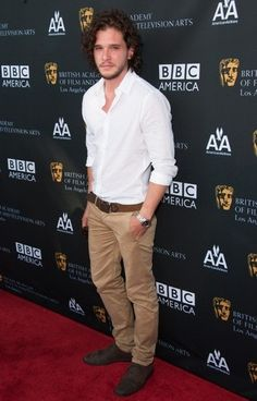 Kit Harington wearing White Longsleeve Shirt, Khaki Chinos, Dark Brown Suede Oxford Shoes, and Brown Leather Belt