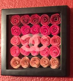 Rolled paper flowers in shadow box with Chanel etched glass