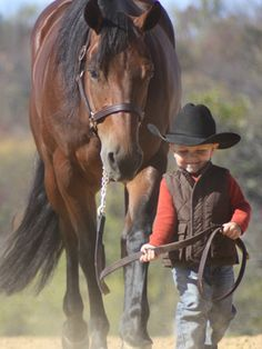 2 year-old Landon with 5 year-old Sugarlee • photo: Parents on Back in the Saddle