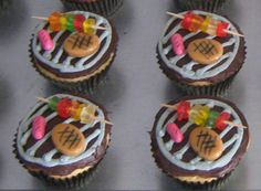 Grill cupcakes by Cupcakes-A-Go-Go in Madison, Wisconsin, with kebabs, hot dog and hamburger (not real meat). http://cupcakestakethecake.blogspot.com/2012/06/mr-and-mrs-wedding-cupcakes.html