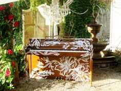 """Painted piano in front of store """"Room 363""""  in downtown Naperville"""