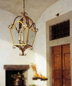 "Medium ""Gubbio"" lantern. Wrought iron with antique gold finish. By effebiweb.com"