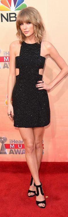 Who made Taylor Swift's black cut out dress, jewelry, and sandals?