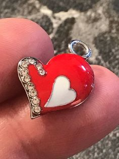 A personal favorite from my Etsy shop https://www.etsy.com/listing/545159519/3-shiny-red-enamel-and-rhinestone-edged