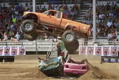 Bob Miller, 76, of Naselle jumps two cars in his converted Toyota pickup  during the Monster Truck Show at the Clark County Fair. Miller started driving on the monster truck circuit after he retired 10 years ago.