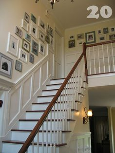 love the stair way...lots of great picture hanging tips on this blog  stairway photo wall_chair rail_20