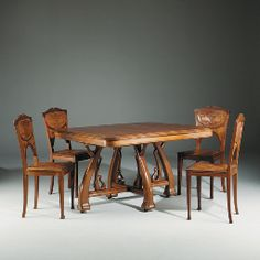 ART NOUVEAU CARVED DINING TABLE AND SIX CHAIRS ENSUITE  DESIGNED BY LEON BENOUVILLE, CIRCA 1895