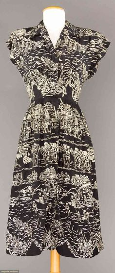 """WW11 MILITARY PRINT DRESS, 1945-1950  May 9, 2017 - CATALOG SALE Sturbridge, Massachusetts Black silk w/ white outline print of U.S. , troops standing at attention in a town square, soldiers landing on beaches at Normandy, towns people cheering passing soldiers, American flags, military vehicles on road, etc., B 36"""", W 26"""", L 42"""", (3 large holes) fair."""