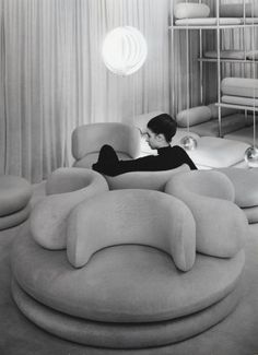 Verner Panton VB here-- I've been doing a similar group of chairs forever, but facing in. Its an interesting twist - but hard on the neck!