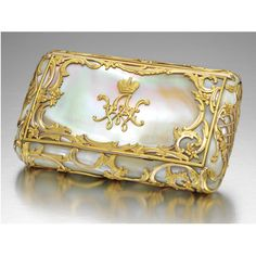 # RARE FABERGÉ MOTHER-OF-PEARL CIGARETTE CASE WITH TWO-COLOUR GOLD MOUNTS, WORKMASTER MICHAEL PERCHIN, ST PETERSBURG, CIRCA 1890 in rococo taste, the lid applied with gold cipher WA for Grand Duke Vladimir Alexandrovich, the whole overlaid with gold scrolls and flowers, the ends with trellis pattern, silver-gilt interior, struck with workmaster's initials and Fabergé in Cyrillic, 84 standard