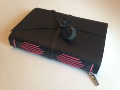 Cobalt Black with Hot Pink thread and cover pages.