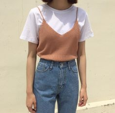 White t-shirt, knit camisole, and high-waisted jeans